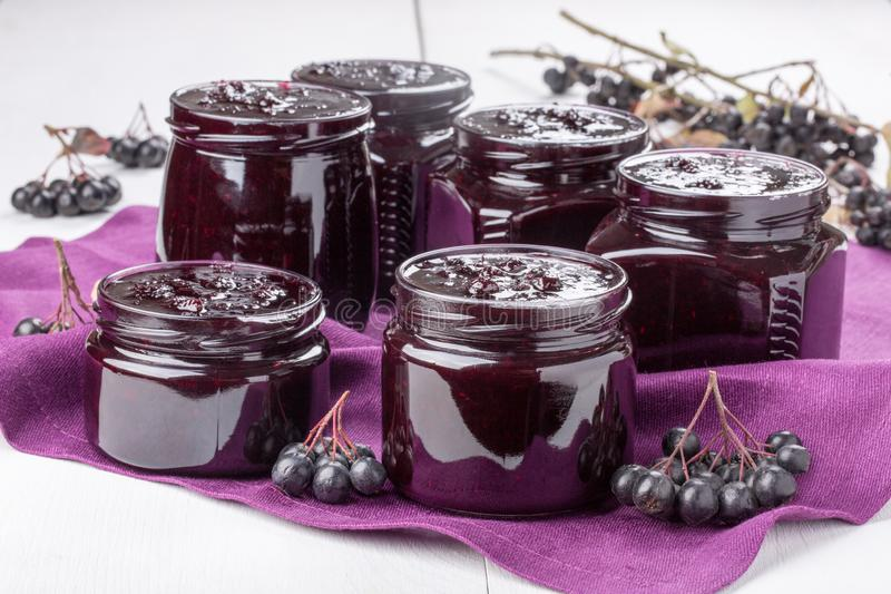 Chokeberry jam in a glass jars. Homemade preserves. Chokeberry jam in glass jars stock photography