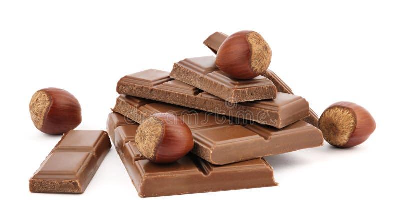 Choklad och hasselnötter royaltyfria foton