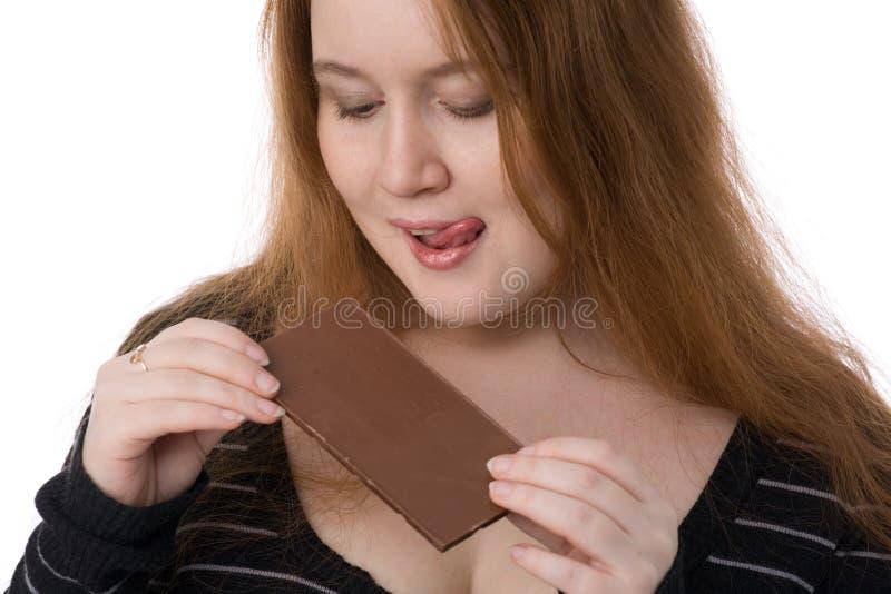 chokladförälskelser som kvinna arkivfoto