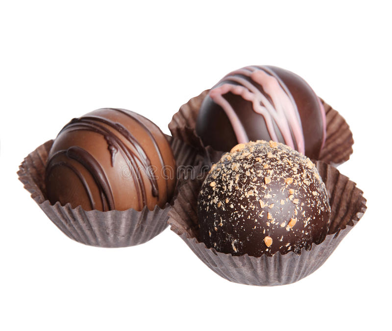 Chokladgodisar. Samling av härliga belgiska tryfflar i det isolerade omslaget arkivfoto