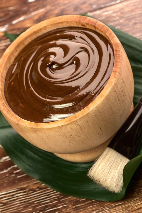 Chokladmaskering fotografering för bildbyråer