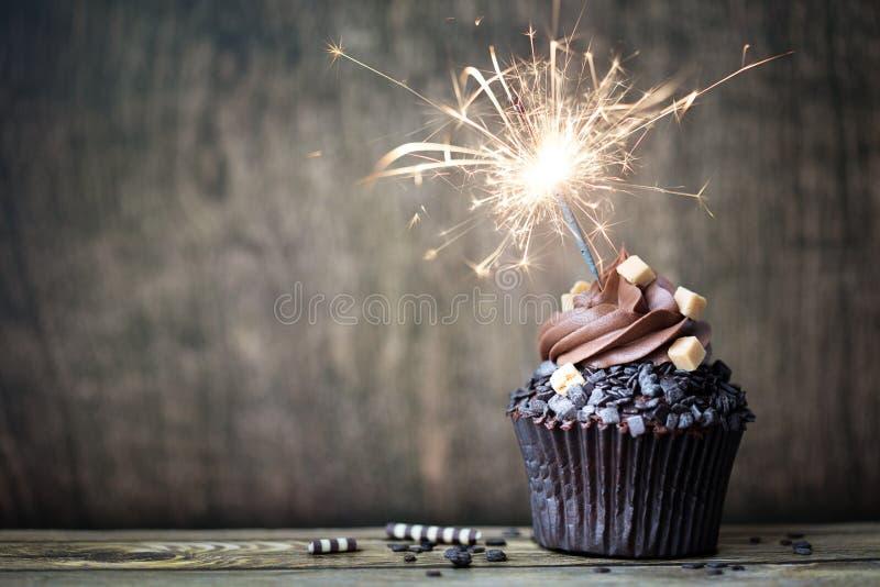 Chokladmuffin med gaffeln royaltyfria foton