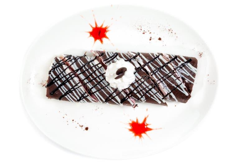 Chokladpannkakor som stoppas med kräm royaltyfri foto