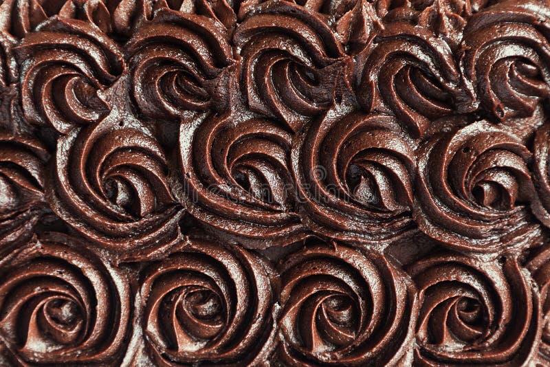 Chokladpralin virvlar runt bakgrund royaltyfria bilder