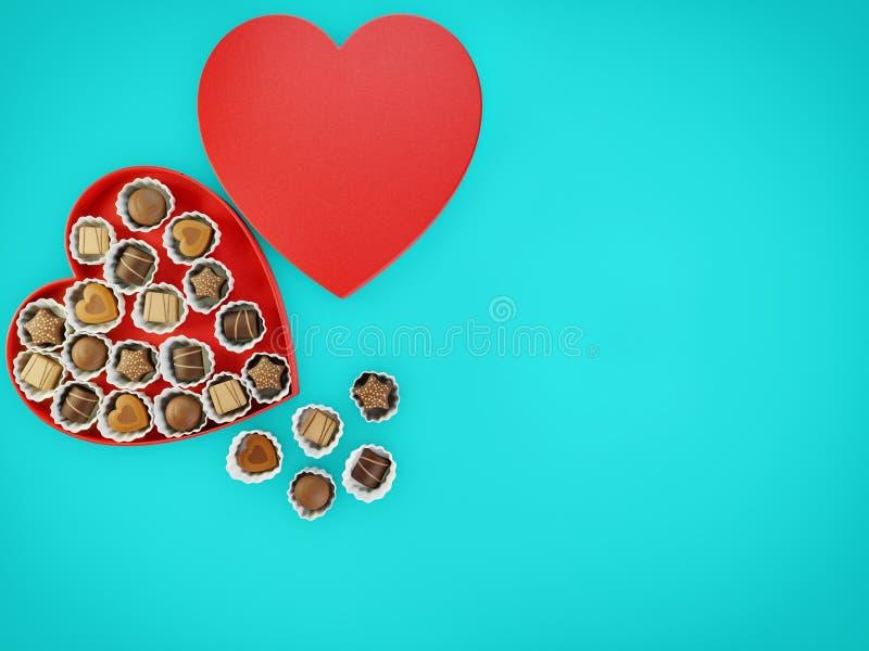 Chokladsötsaker i en röd hjärta formad ask med copyspace för text över en blå flatlay bakgrund royaltyfria bilder