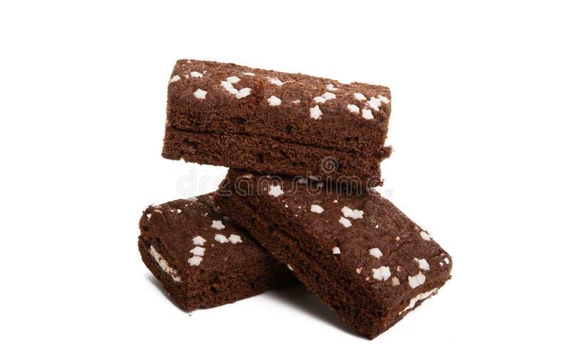 chokladsockerkaka med isolerade stjärnor arkivfoton