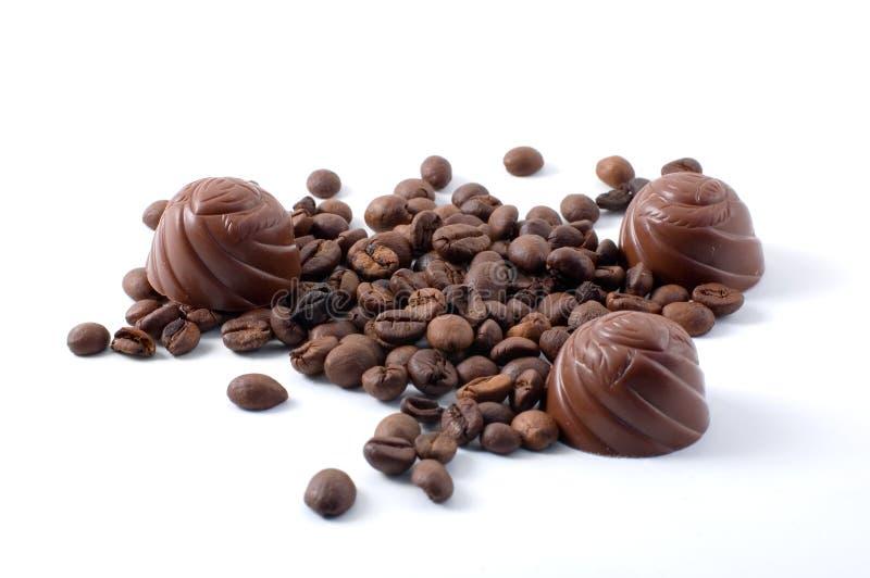 Chokolate candies and coffee beans royalty free stock photo