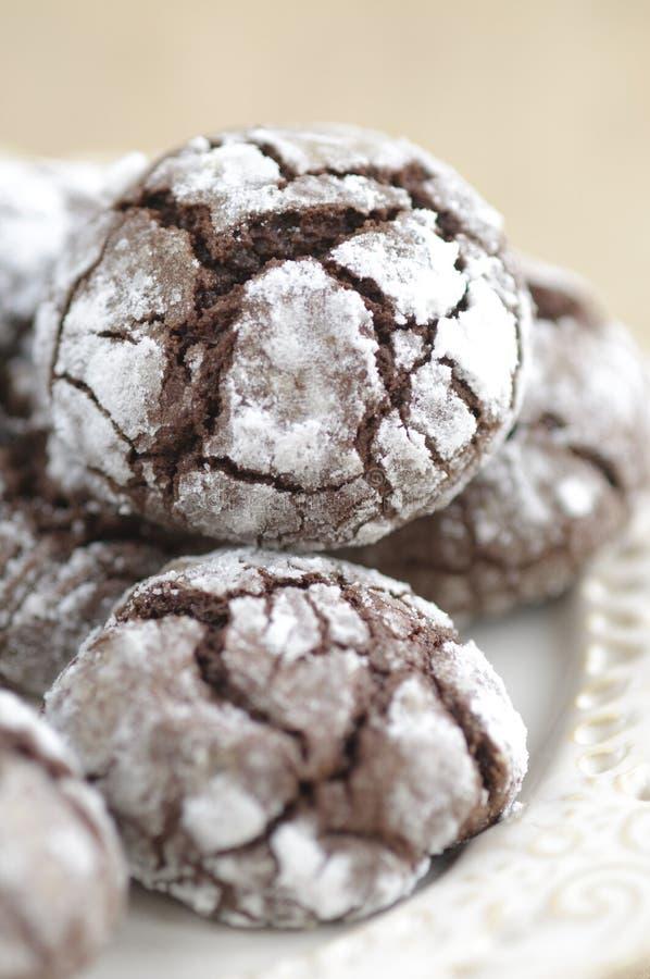 Chokolate crinkles cookies. With icing sugar stock photography