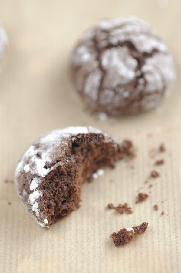 Chokolate crinkles cookies. With icing sugar royalty free stock images