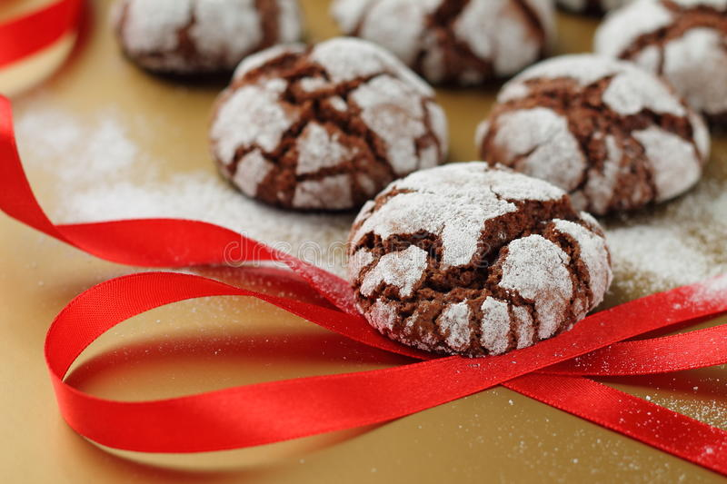 Chokolate crinkles cookies. On a golden table stock images