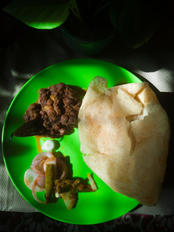 Chole Bhature a Indian fast food served with fried bread & chick peas & chopped onions pickle for sides royalty free stock photo