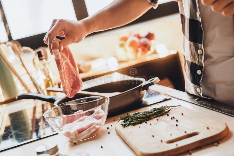 Cholesterol eat. Man cooking fat beef royalty free stock images