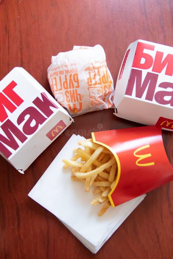 Cholesterol and obesity. Russia, St. Petersburg, January 22, 2019: Hamburger menu at McDonald`s French Fries, Big Mac. Fast food royalty free stock image
