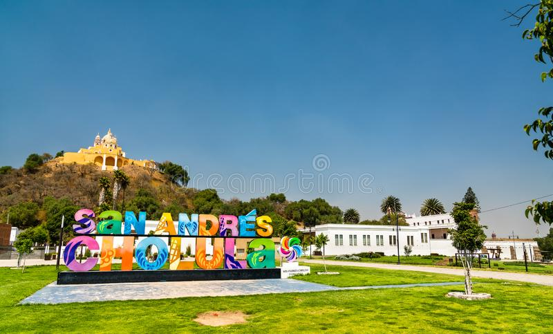 Sign San Andres Cholula and the Church of Our Lady of Remedies, Mexico. Cholula, Mexico - March 14, 2019: Sign San Andres Cholula and the Church of Our Lady of stock images
