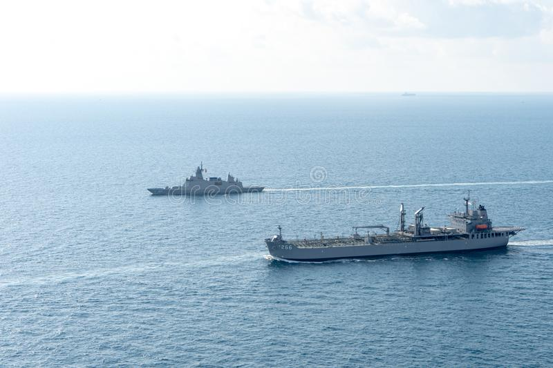 Bhumibol Adulyadej stealth frigate and HMAS Sirius fleet replenishment vessel  sail in the sea stock photo
