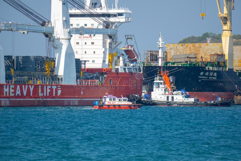 Pilot boat sails out to the entrance of the Chuk Samet Deep sea port stock image