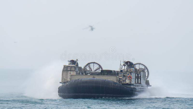 US Marine Corps Landing Craft Air Cushion or LCAC sails in the sea. CHONBURI, THAILAND - FEBRUARY 17, 2018: US Marine Corps Landing Craft Air Cushion or LCAC stock images