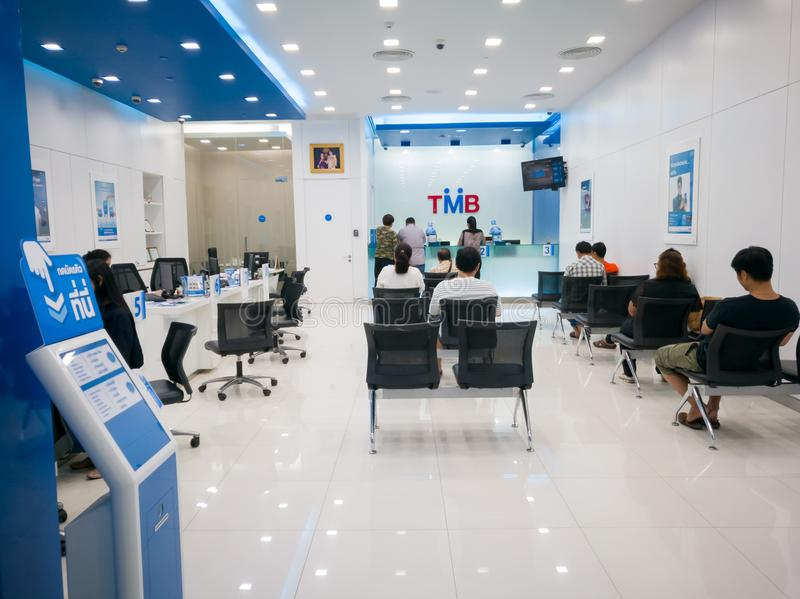 Chonburi, Thailand, July 2017: Bank counter service and people waiting for financial transaction in the bank stock images