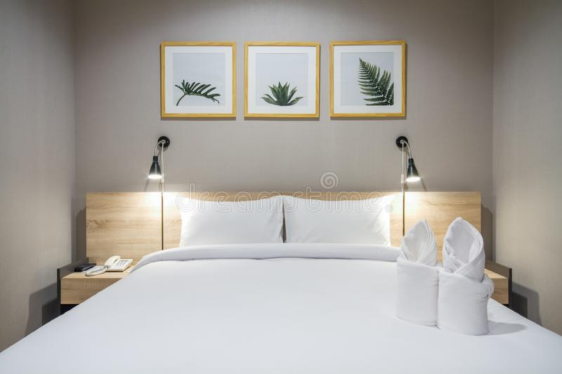 Chonburi, Thailand – June 24, 2018 : White pillows on a comfortable bed with cozy bedroom stock image