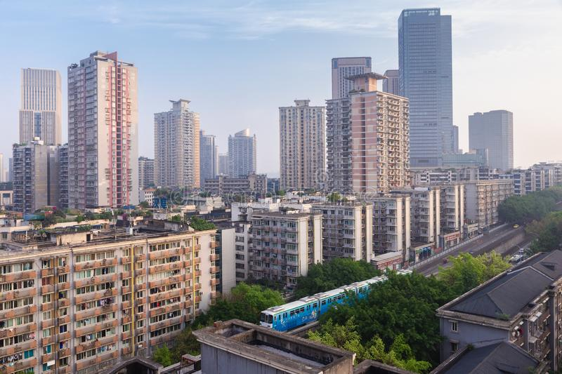City view of Chongqing high rise buildings, modern residential, shopping center and electric train. Chongqing, China royalty free stock photography
