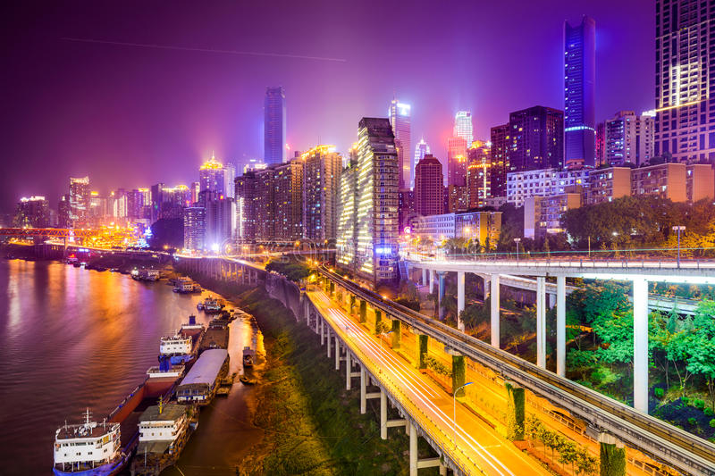 Chongqing, China Riverside Cityscape. At night royalty free stock image
