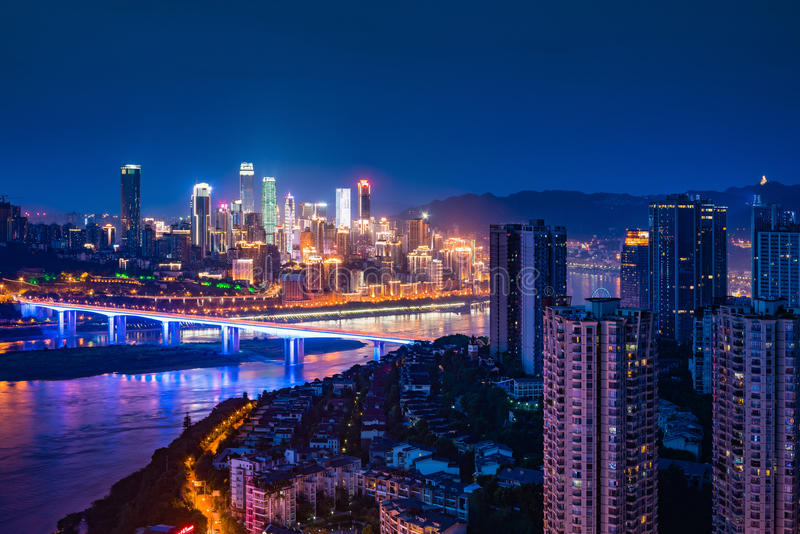 Chongqing City Night Light. Over jialing river with boat and skyscraper and colorful reflections stock image