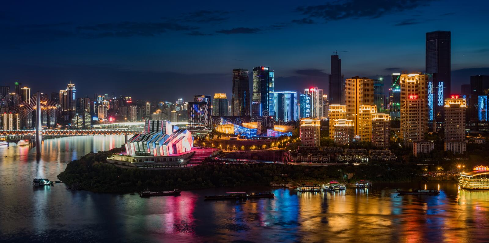 Chongqing City Night Light. Over jialing river with boat and skyscraper and colorful reflections stock images