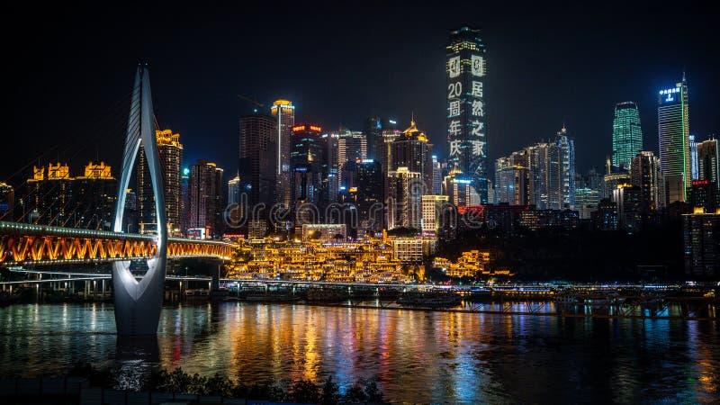 Chongqing city nightscape with bridge buildings and Hongya Cave view illuminated at night in Chongqing China stock photos
