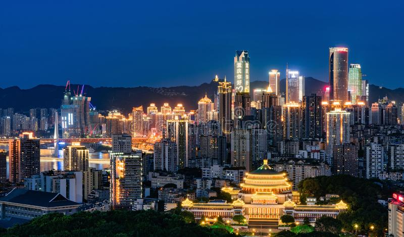 Chongqing Night Skyline. Illuminated sign with the word `Hello, Chongqing! Hello, World` on the top of WFC of Chongqing, China royalty free stock photography