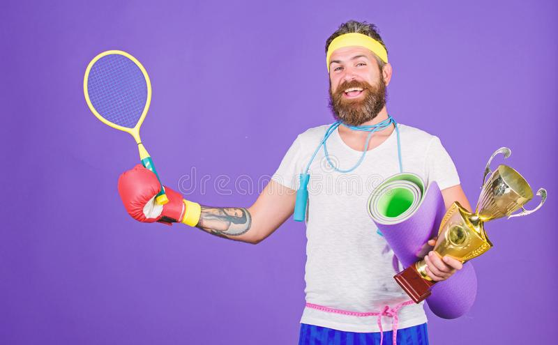 Choose favorite sport. Sport concept. On way to achievement. Man bearded athlete hold sport equipment jump rope fitness royalty free stock images