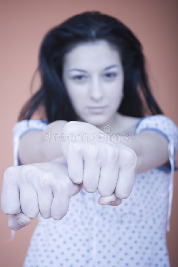 Choose a fist. Brunette woman with crossed fists. choose a fist game stock photography