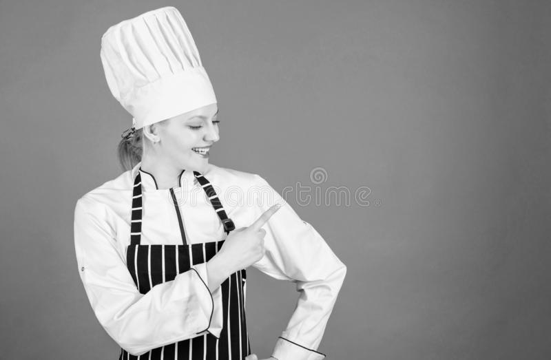 Choose items from a la carte menu. Pretty female cook pointing finger away and offering menu. Advertising for your. Restaurant menu. Menu list, copy space royalty free stock images