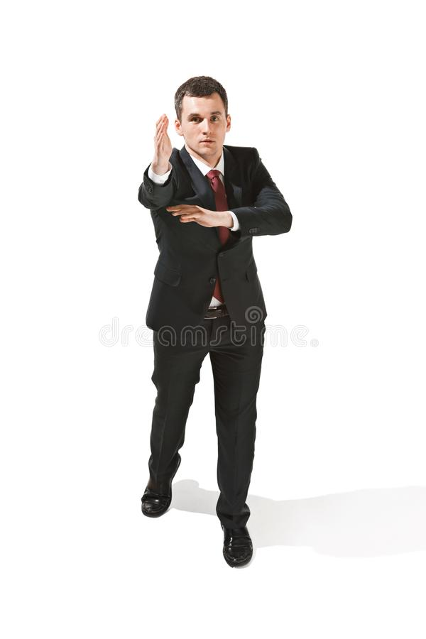 Above portrait of a businessman with very serious face. Confident professional with piercing look in the foreground of stock photography