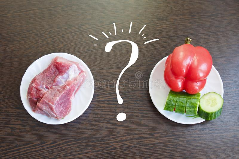 choose between meat and vegetables. choice between vegetarians and meat eaters royalty free stock image