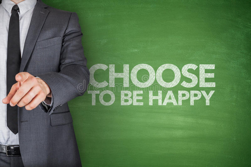 Choose to be happy on blackboard royalty free stock photo