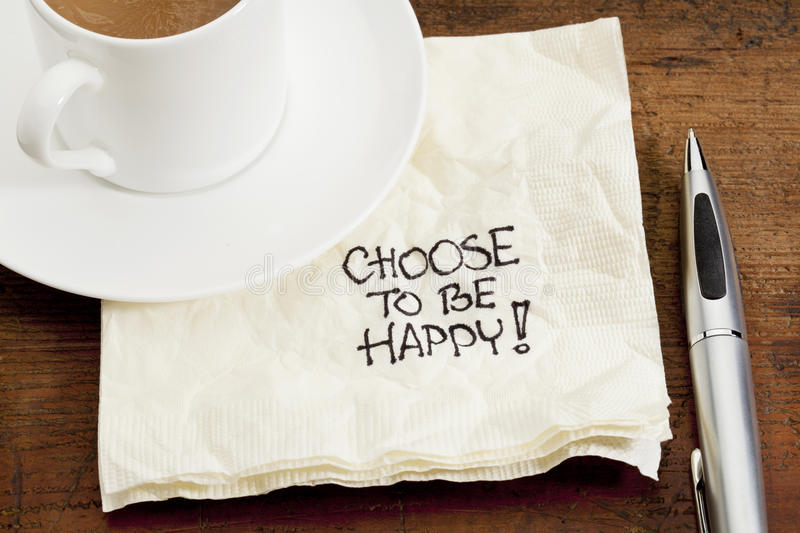 Choose to be happy on a napkin stock photos