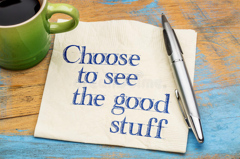 Choose to see good stuff. Positive advice - handwriting on a napkin with cup of coffee royalty free stock photo