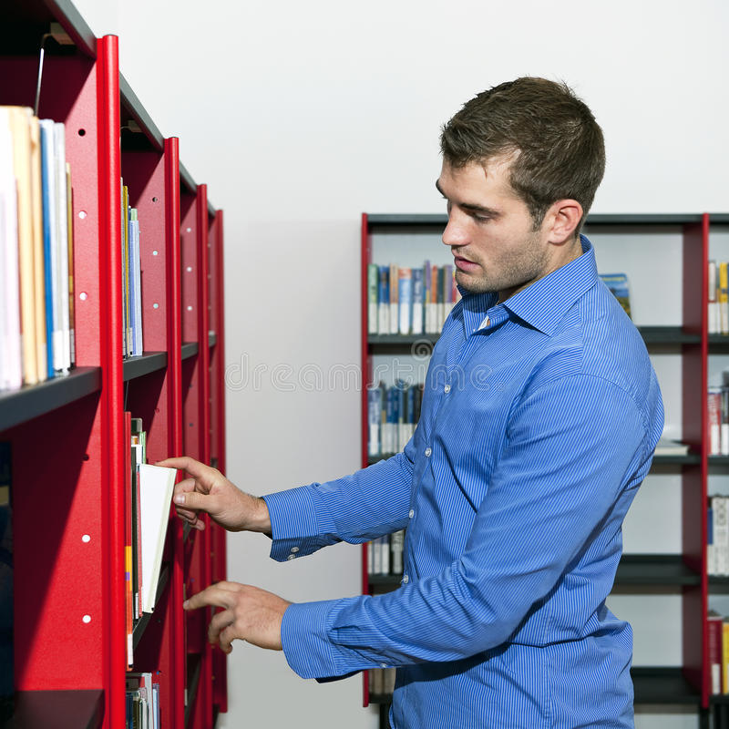 Download Choosing a book stock image. Image of shirt, sparse, interior - 22042833