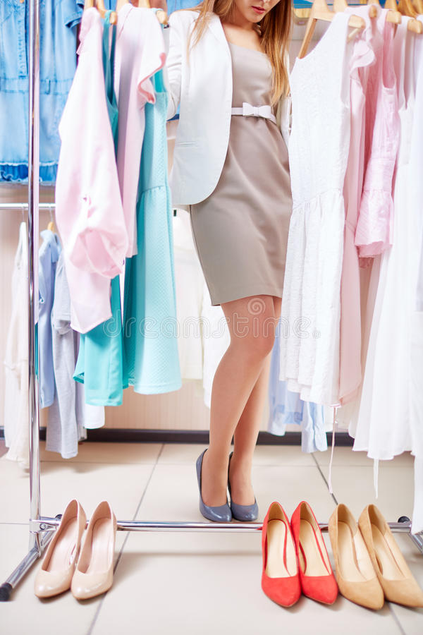 Choosing clothes and shoes royalty free stock images