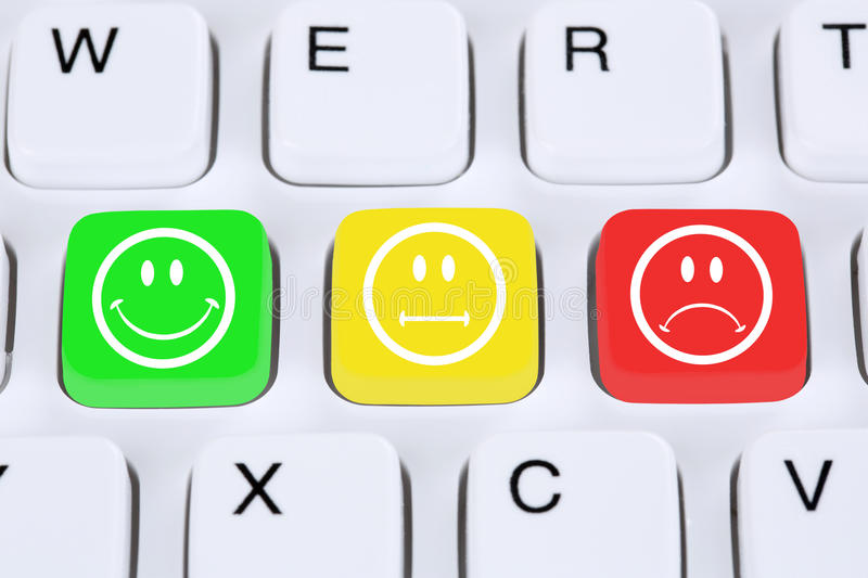 Choosing customer service quality with smiley on computer keyboard stock photo