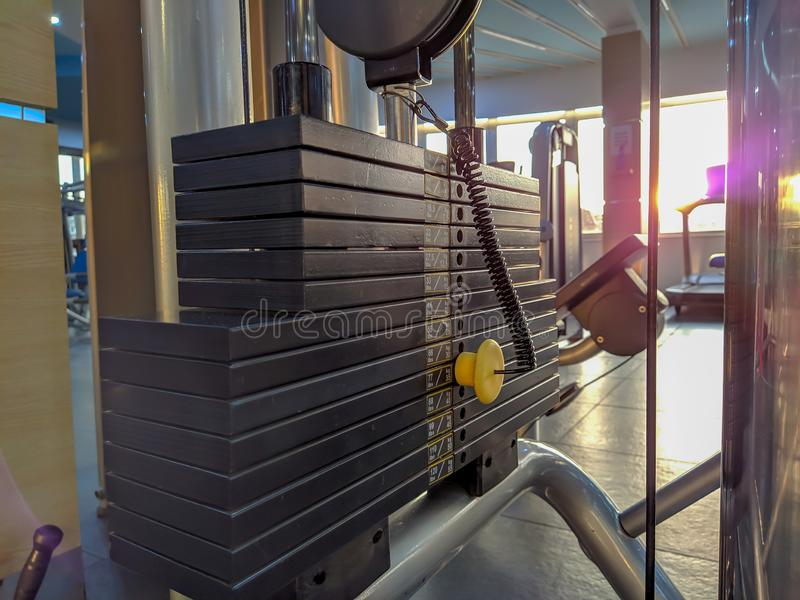 Choosing different weight options for weight lifting in a gym during an everyday workout training for increasing muscle mass stock photography