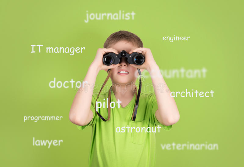 Choosing future profession concept. Cute boy with binoculars on royalty free stock photos