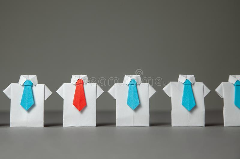Choosing good employee leader. Staff recruitment. Pretenders in white shirt and blue ties, elected leader in red tie stock photography