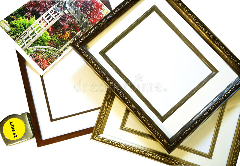 Choosing a Picture Frame. Three frames with a tape measure and a picture stock photo