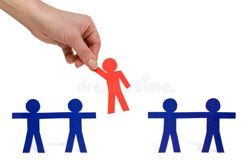 Choosing the red person from a group stock image