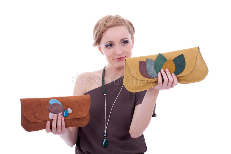 Choosing between two nice purses stock photography
