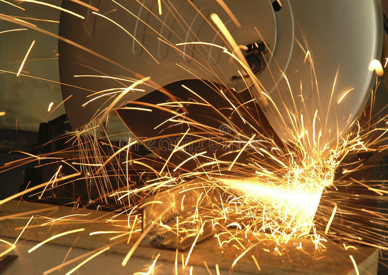 Chop Saw. Sparks flying as a circular chop saw cuts through metal royalty free stock images