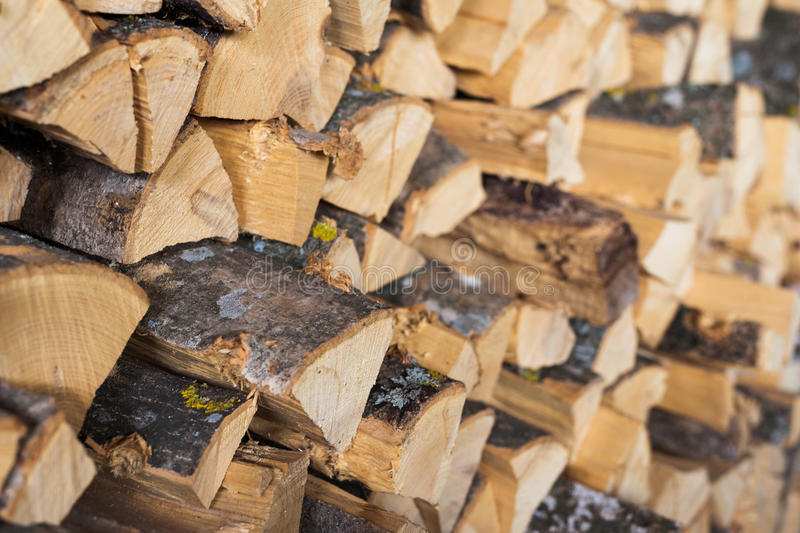 Chopped brown firewood, stacked and ready for winter. Stack of wood, background royalty free stock images