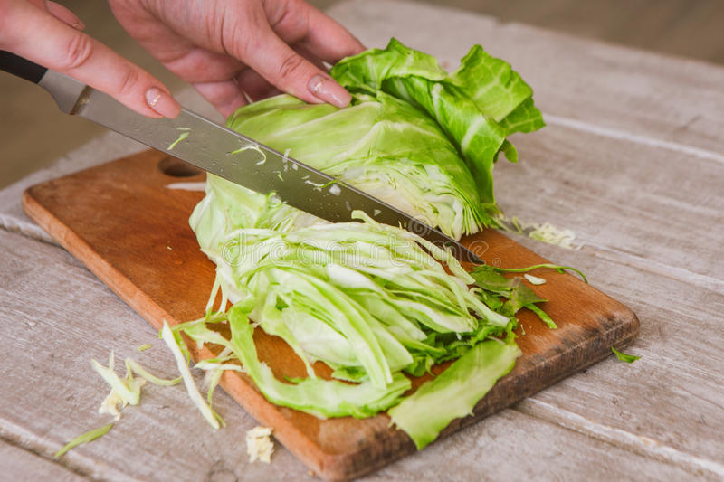 Chopped cabbage on wooden desk stock photos