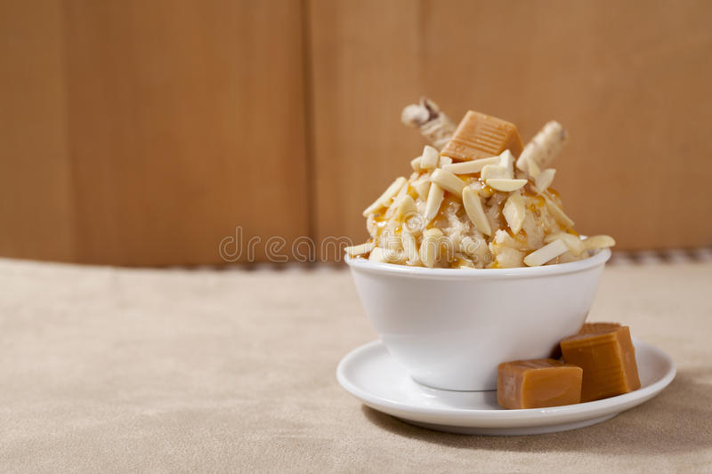 Chopped caramel. Almond ice cream with chopped caramel royalty free stock image